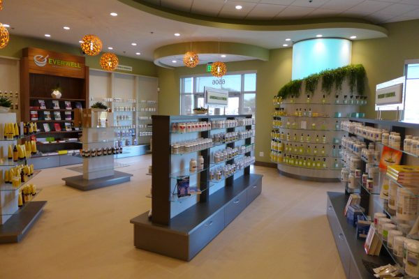 Everwell Pharmacy, Florida, Front End with drawers and curved wall element with LED, Firma AT Design Team.